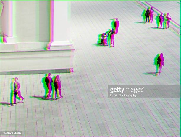 manipulated image of bird's eye view of walking people - spionage und aufklärung stock-fotos und bilder
