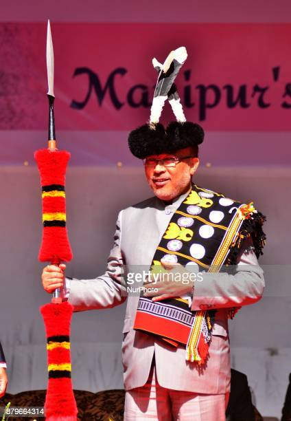 Manipur Chief Minister N Biren Singh is presented with Mao Naga traditional attires at the Manipur 1St Cherry Blossom Festival cum Flower festival at...