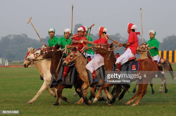 Manipuri players in traditional dress on their ponies playing traditional polo known as Sagol Kangjei during to mark the 46th anniversary of Vijay...