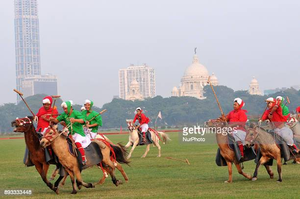 Manipuri players in traditional dress on their ponies playing traditional polo known as Sagol Kangjei during the Vijay Diwas a ceremony to celebrate...