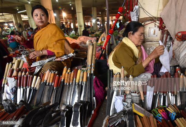 Manipuri vendors sell traditional knifes at The Ima Keithel Market or 'Mother's Market' in Imphal on March 5 2017 The market in the northeastern...