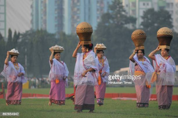 Manipuri women with their traditional dress perform dance during to mark the 46th anniversary of Vijay Diwas at RCTC ground on December 14 2017 in...