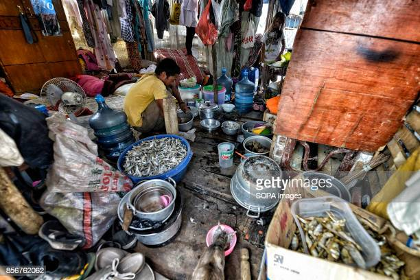 A manis seen cleaning fish to eat at his house in the Pasar Ikan neighborhood of Jakarta In April last year hundreds of soldiers and police stormed...