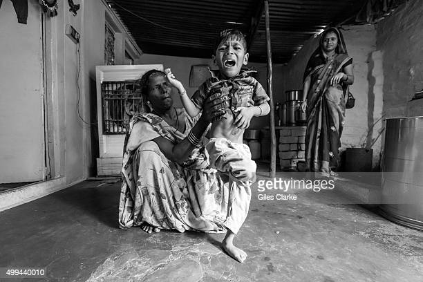Manish 4 years old with his mother Pooja at home in the Mata ki Madiya neighborhood Manish was born to parents contaminated by a carcinogenic and...