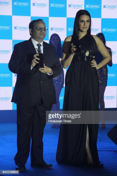Manish Aggarwal CEO Centric Mobile and Bollywood actor Neha Dhupia during the launch of Centric Smartphones new range at ITC Maratha Andheri on...