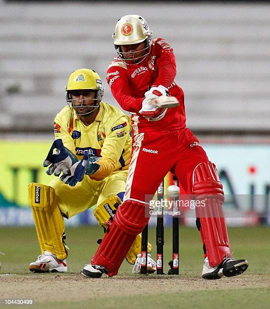 AFRICA SEPTEMBER 24 Manish Dhoni hits away as MS Dhoni keeps wicket during the Airtel Champions League Twenty20 semifinal match between Chennai Super...