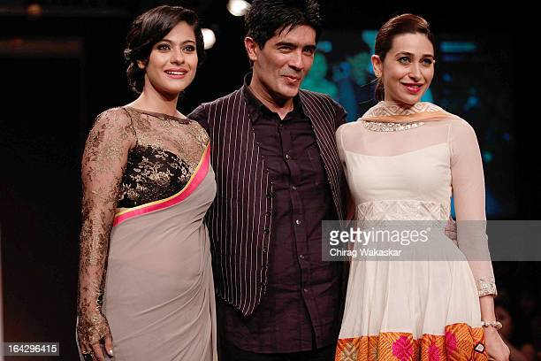 Manish Malhotra on the runway with Kajol Karishma Kapoor during Lakme Fashion Week Summer/Resort 2013 Day 1 at Grand Hyatt on March 22 2013 in Mumbai...