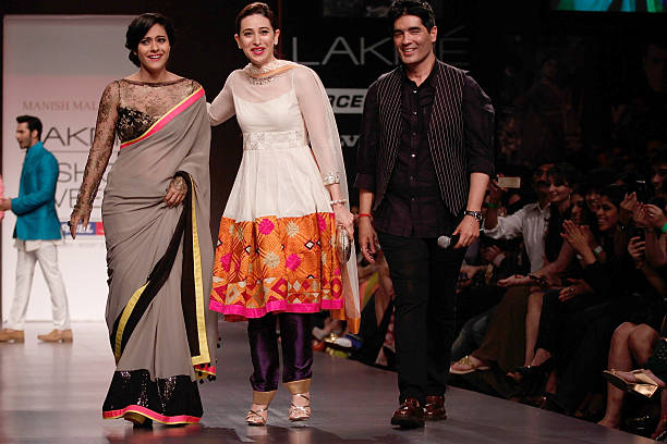 Manish Malhotra on the runway with Kajol Karishma Kapoor during Lakme Fashion Week Summer/Resort 2013 Day 1 at Grand Hyatt on March 22 2013 in Mumbai.