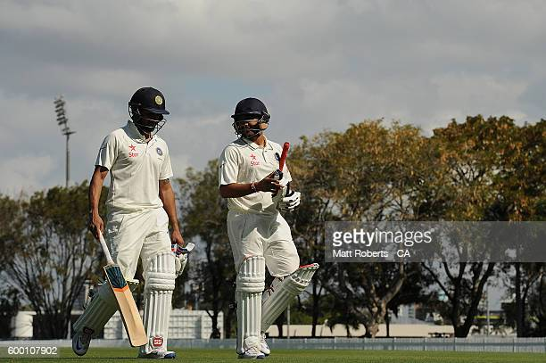 Manish Pandey and Karun Nair of India A leave the field after the second session during the Cricket Australia Winter Series match between Australia A...