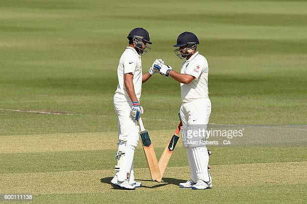 Manish Pandey India A celebrates reaching his half century with Karun Nair during the Cricket Australia Winter Series match between Australia A and...
