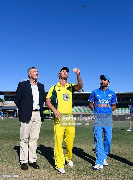 Manish Pandey of India A and Chris Lynn of Australia A perform the coin toss before the start of play during the One Day match between Australia A...