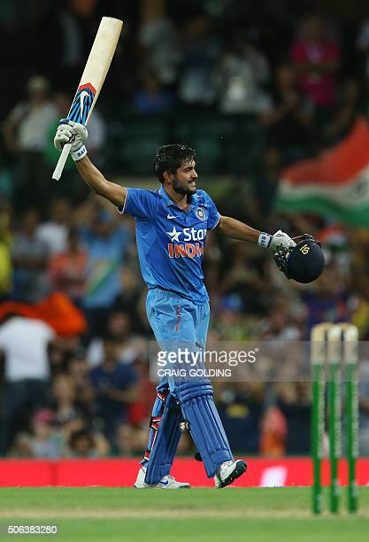 Manish Pandey of India celebrates his century during the fourth oneday international cricket match between India and Australia in Sydney on January...