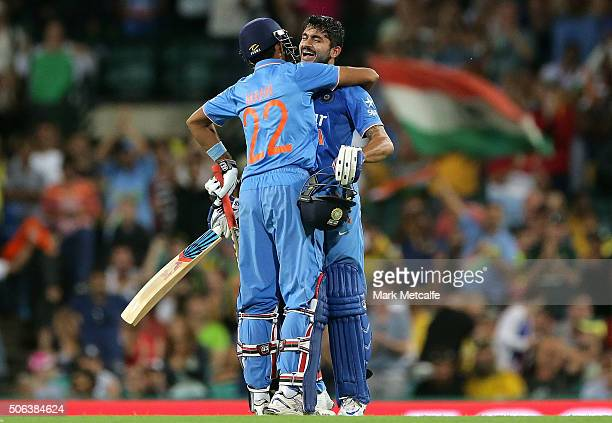Manish Pandey of India celebrates with Gurkeerat Mann Singh after scoring a century during game five of the Commonwealth Bank One Day Series match...