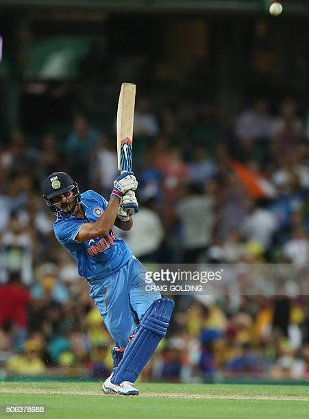Manish Pandey of India hits a six during the fourth oneday international cricket match between India and Australia in Sydney on January 23 2016...