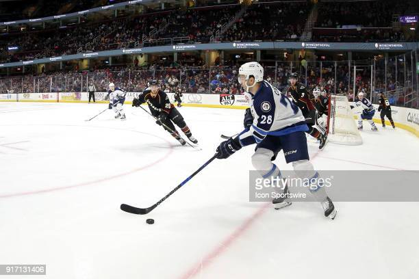 Manitoba Moose center Patrice Cormier controls the puck during the first period of the American Hockey League game between the Manitoba Moose and...