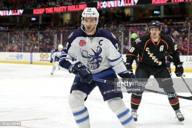 Manitoba Moose center Patrice Cormier follows the puck into the corner during the first period of the American Hockey League game between the...