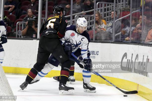 Manitoba Moose center Patrice Cormier plays the puck as Cleveland Monsters defenceman Ryan Collins defends during the third period of the American...