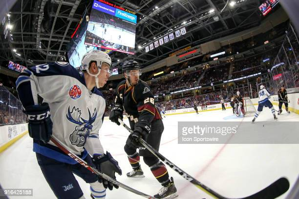 Manitoba Moose left wing Darren Kramer is defended by Cleveland Monsters defenceman Doyle Somerby during the first period of the American Hockey...