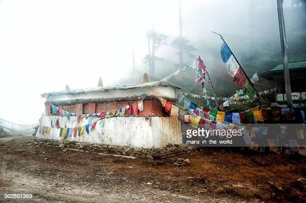 Mani-Wall with prayer flags on Thrumsingla, Bhutan.