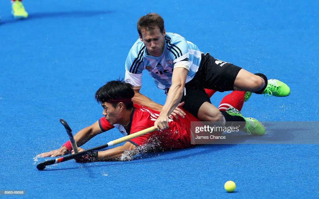 Manjae Jung of South Korea and Facundo Callioni of Argentina battle for the ball during the Pool A match between Korea and Argentina on day one of Hero Hockey World League Semi-Final at Lee Valley Hockey and Tennis Centre on June 15, 2017 in London, England.