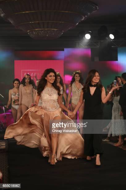 Manjari Fadnis walks the runway with Karishma Jumani during India Intimate Fashion Week 2017 at Hotel Leela on March 18 2017 in Mumbai India