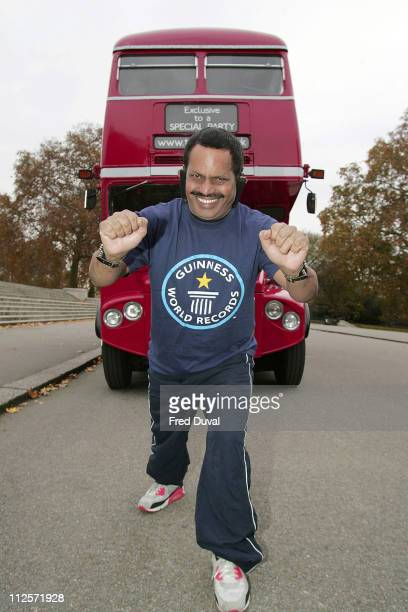 Manjit Singh attempts to break a Guinness World Record by pulling a double decker bus in the fastest time with his ears in front of the Royal Albert...