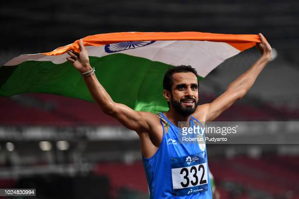 Manjit Singh of India celebrates victory after winning Men's 800m on day ten of the Asian Games on August 28 2018 in Jakarta Indonesia
