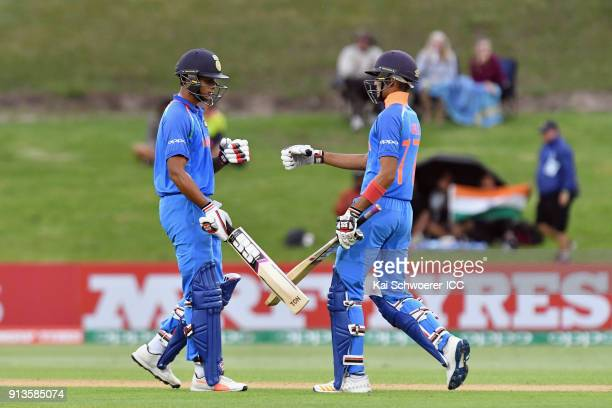 Manjot Kalra of India is congratulated by Shubman Gill of India after scoring a half century during the ICC U19 Cricket World Cup Final match between...