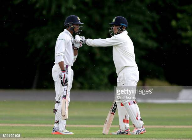 Manjot Kalra of India is congratulated by teammate Riyan Parag after he reaches a half century during the England U19 v India U19 match at Queen's...