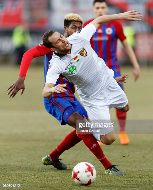 Manjrekar James of Vasas FC fouls Marton Eppel of Budapest Honved during the Hungarian OTP Bank Liga match between Vasas FC and Budapest Honved at...
