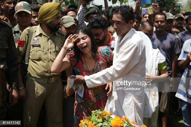 Manju devi sister of slain Indian soldier Satish Bhagat wails during the last rituals for her brother at Shamachak village about 25 kms from Jammu on...