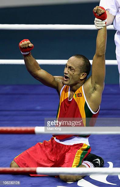 Manju Wanniarachchi of Sri Lanka celebrates winning the gold medal after the in the Bantam Weight Men Finals Gold Medal Bout against Sean McGoldrick...