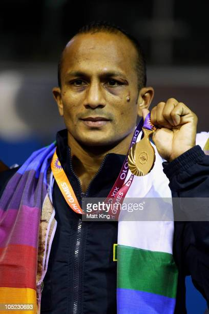 Manju Wanniarachchi of Sri Lanka poses with the gold medal during the medal ceremony for the Bantam Weight Men Finals Gold Medal Bout at Talkatora...