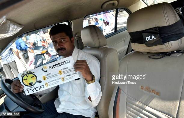 Manjunath an OLA driver flaunts Namma TYGR sticker ahead of its inauguration by former Prime Minister HD Deve Gowda at Town Hall on November 29 2017...
