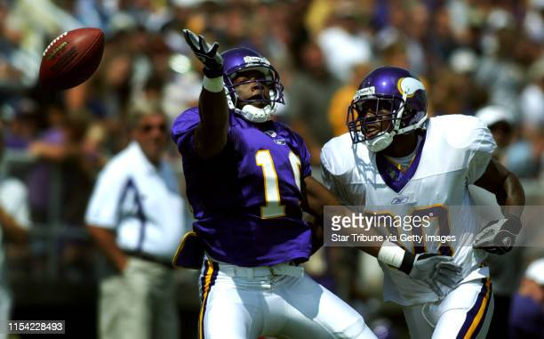 Mankato MN, 8/2/03 Vikings trainnig camp-----Vikings receiver Jermaine Mays left can not control a pass, as Vikings corner back Willie Miles plays...