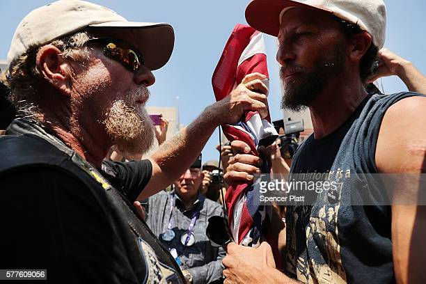 Man,left, yells at an anarchist for his treatment of the American Flag near the the site of the Republican National Convention in downtown Cleveland...