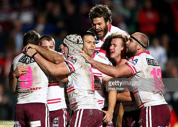 Manly celebrate a try by Kieran Foran during the round 15 NRL match between the Manly Warringah Sea Eagles and the Parramatta Eels at Brookvale Oval...