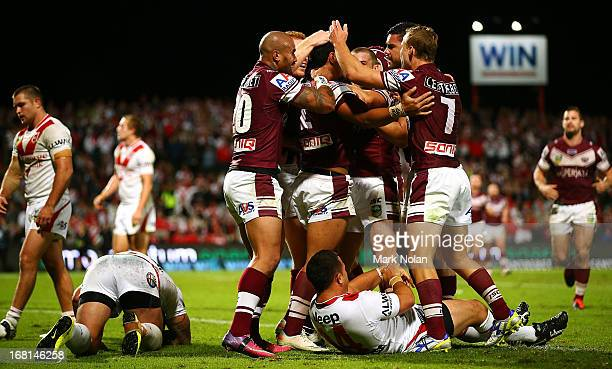 Manly celebrate the winning try by Jorge Taufua during the round eight NRL match between the St George Illawarra Dragons and the Manly Sea Eagles at...