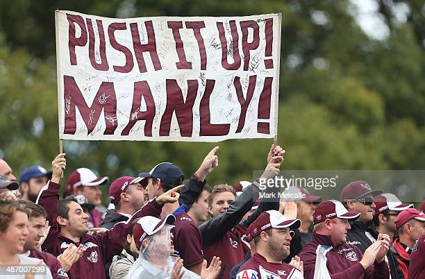 Manly fans celebrate a try during the round 8 NRL match between the ManlyWarringah Sea Eagles and the Canberra Raiders at Brookvale Oval on April 27...
