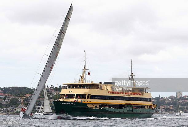 Manly ferry cuts across the bow of Wild Oats XI during the Cruising Yacht Club of Australia 2009 SOLAS Big Boat Challenge on Sydney Harbour on...