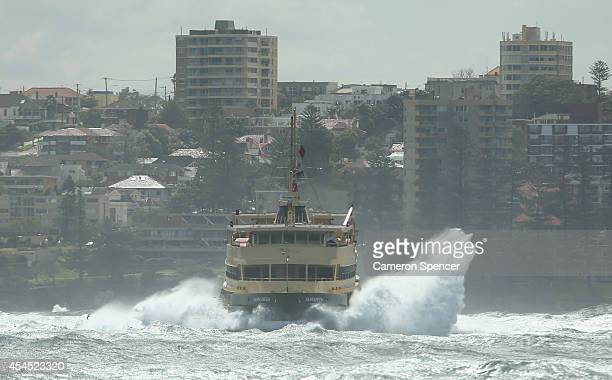 Manly ferry heads over large swells in Sydney Harbour on September 3 2014 in Sydney Australia Sydney's beaches and the harbour have been hit by large...