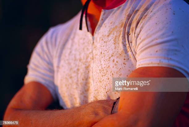 manly man with dirty shirt and arms folded - imperfection stock pictures, royalty-free photos & images