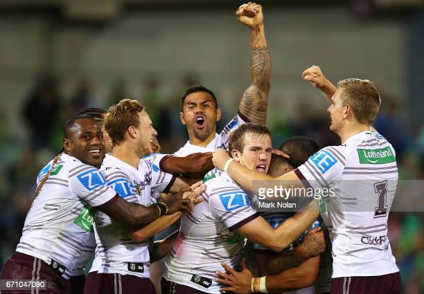 Manly players celebrate winning in extra time after a penalty goal by Dylan Walker the round eight NRL match between the Canberra Raiders and the...