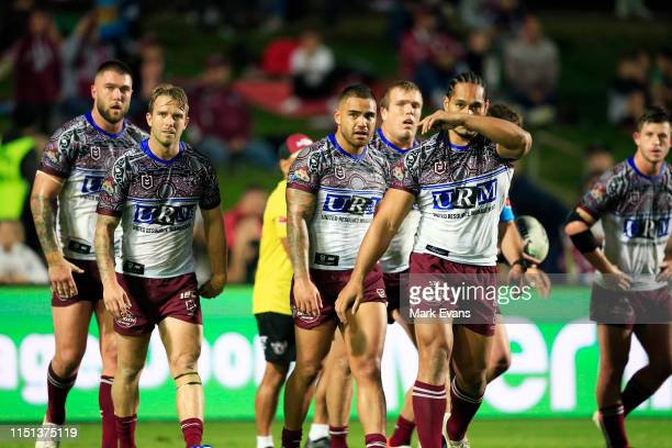 Manly players look on after conceding a try to the Titans during the round 11 NRL match between the Manly Sea Eagles and the Gold Coast Titans at...