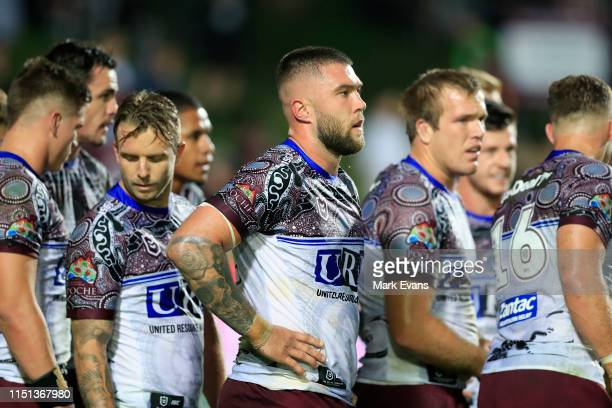 Manly players look on after conceding a ty to the Titans during the round 11 NRL match between the Manly Sea Eagles and the Gold Coast Titans at...