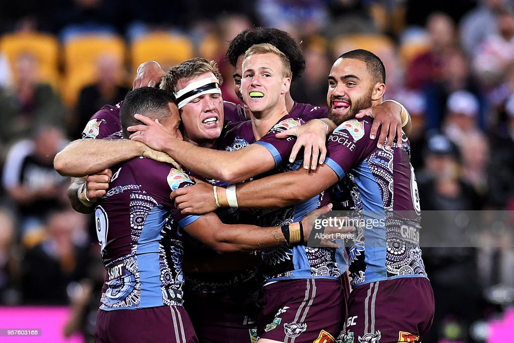 Manly Sea Eagles players celebrate a Apisai Koroisau try during the round ten NRL match between the Manly Sea Eagles and the Brisbane Broncos at Suncorp Stadium on May 12, 2018 in Brisbane, Australia.