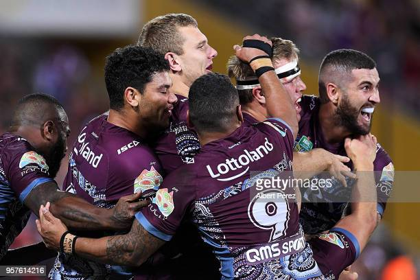 Manly Sea Eagles players celebrate a Joel Thompson try during the round ten NRL match between the Manly Sea Eagles and the Brisbane Broncos at...