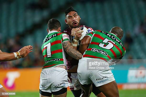 Manly's Jesse Sene-Lefao is tackled by Rabbitohs Lote Tuqiri and Adam Reynolds during the match at Allianz Stadium. Sydney, Australia. Friday 12th...