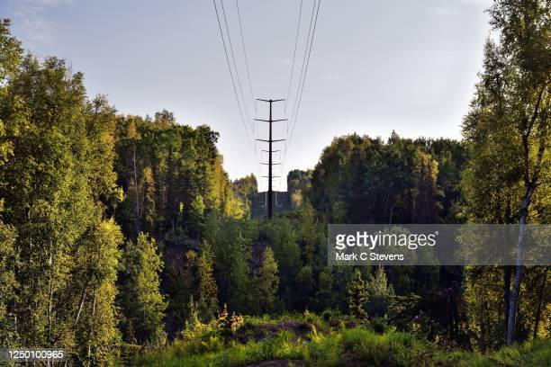 man-made power flowing through the mountains of alaska. - chugach state park stock pictures, royalty-free photos & images