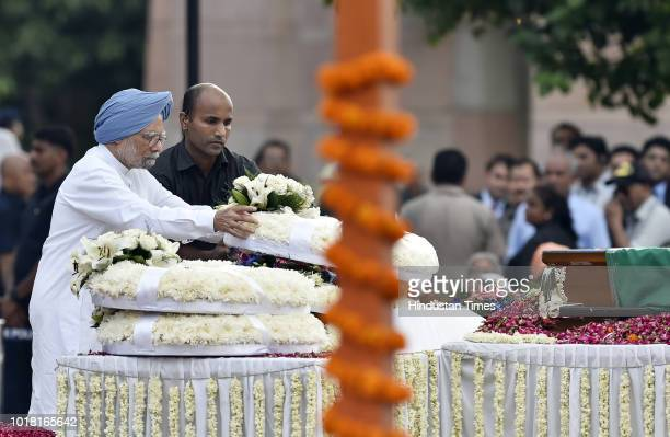 Manmohan Singh Former Prime Minister of India pays his last respect to former Prime Minister Atal Bihari Vajpayee during his cremation ceremony at...